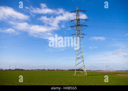 electricity transmission tower on a power house - Stock Photo