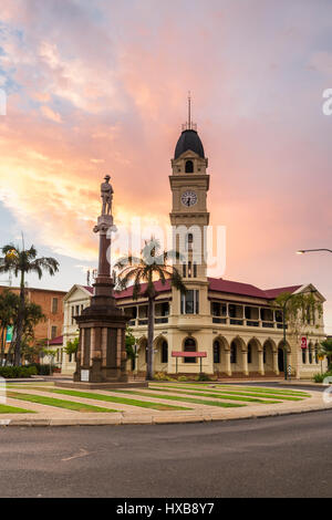 Sunset view of the Bundaberg Post Office and clock tower, along with the Cenotaph War Memorial.  Bundaberg, Queensland, - Stock Photo