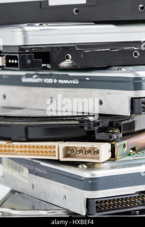 Pile of old hard drives on white background. - Stock Photo