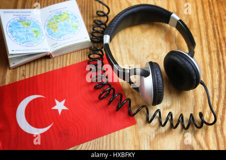 course language headphone and flag on a table - Stock Photo