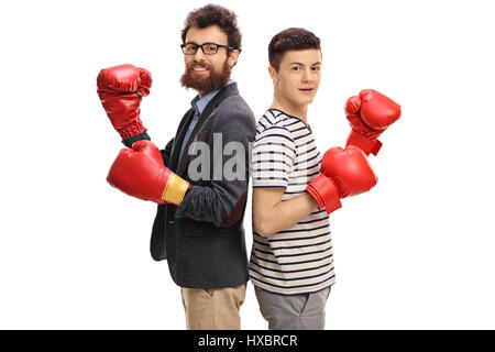 Man and teenage boy wearing boxing gloves and looking at the camera isolated on white background - Stock Photo