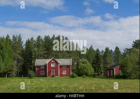 red wooden farm house in sweden - Stock Photo