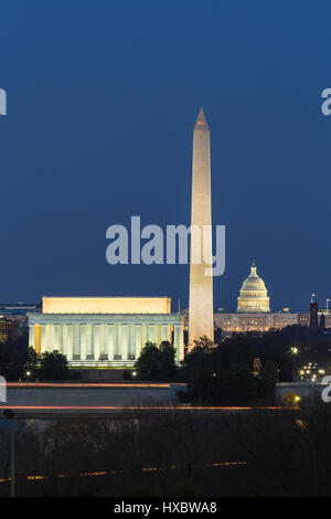 The Lincoln Memorial, Washington Monument, and US Capitol building illuminated during evening twilight in Washington, - Stock Photo