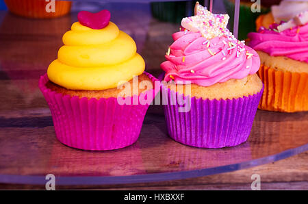 Colourful,traditional cupcakes on street market stall in Stoke on Trent,Staffordshire,United Kingdom. - Stock Photo