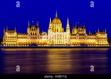 A view of the hungarian parliament during blue hour in budapest, hungary - Stock Photo