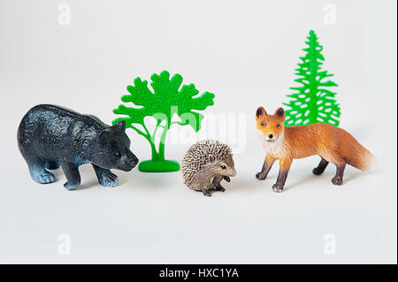 little animal toys Fox, bear and hedgehog on white background - Stock Photo