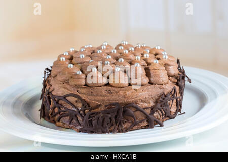 Three flour chocolate cake with, mousse cream - Stock Photo