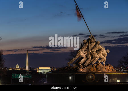 The US Marine Corps War Memorial with Washington landmarks in the background during morning twilight in Arlington, - Stock Photo