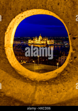 A view of the hungarian parliament at night from fishermen's bastion in budapest , hungary - Stock Photo