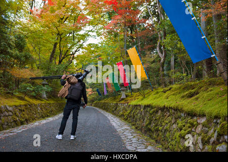 Photographer in Japanese garden in Kyoto during autumn - Stock Photo