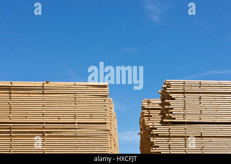 Stacked wooden slats on an industrial area in the harbour, Stacked wooden slats on in industrial site in the harbour - Stock Photo