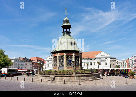 Marketplace of the Hanseatic town Wismar with the pavilion water art, Market Square Wismar with the pavilion fountain - Stock Photo