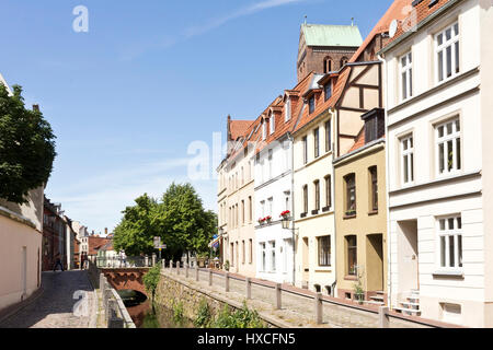Mill pit Brook in the Old Town of Wismar with the St. Nikolai church, million Brook mine in the old town of Wismar - Stock Photo
