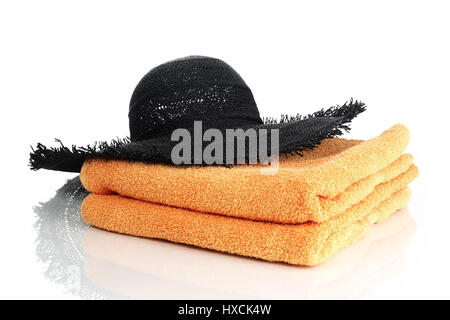 Care with towels, Hut mit Handtüchern - Stock Photo