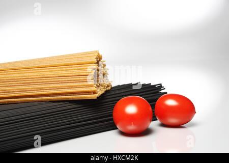 Spaghetti with tomatoes, Spaghetti mit Tomaten - Stock Photo