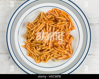 Colourful Flat Lay Image Of Tinned Spaghetti In Tomato Sauce On Toast Meal Ready To Eat - Stock Photo