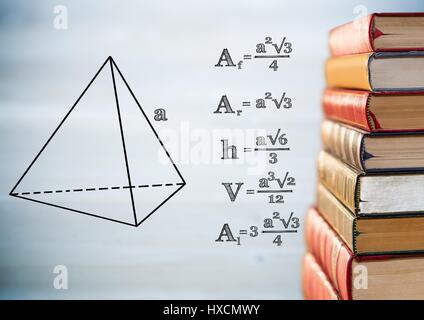 Digital composite of Pile of books with black math graphics against blurry grey wood panel - Stock Photo