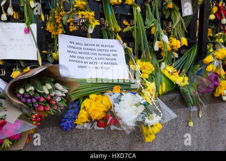 London, UK. 28th March 2017. Flowers and tributes in Parliament Square opposite Parliament in Westminster , in response - Stock Photo