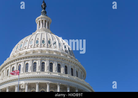 An offset view of the dome of the U.S. Capitol Building in Washington, DC. - Stock Photo