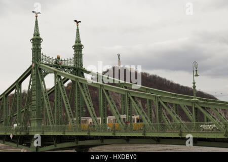 View of Liberty Bridge with tram crossing in Budapest Hungary - Stock Photo