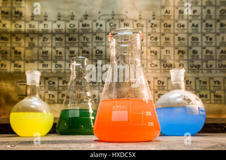 Vintage chemical lab with color beakers - Stock Photo