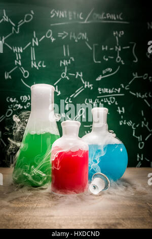 Academic laboratory with beakers and books - Stock Photo