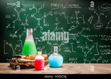 School laboratory with books and beakers - Stock Photo