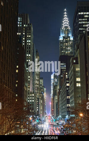 NYC streets at night. Midtown Manhattan - 42nd Street with Chrysler Building. - Stock Photo