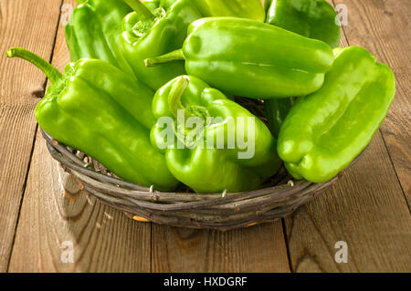 Green Bell Peppers in a basket - Stock Photo