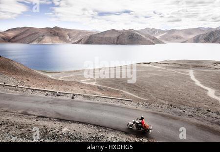 Road overlooking Pangong Tso Lake in Western Himalayas near India-China border - Stock Photo