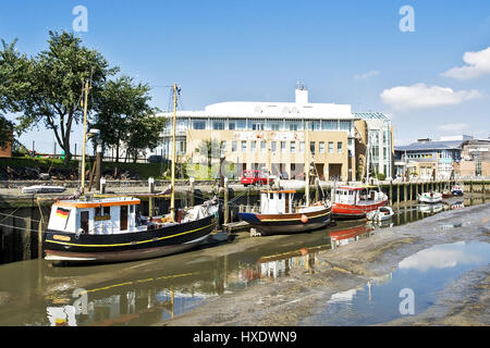 Fishing boats in the harbour basin with low tide, Fischerboote im Hafenbecken bei Ebbe - Stock Photo