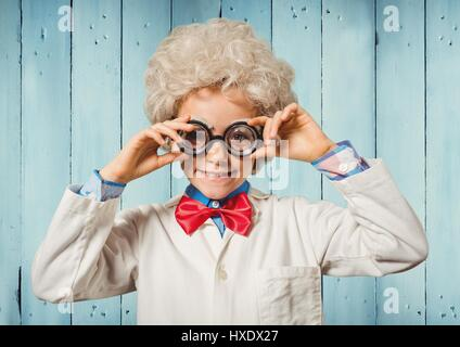 Digital composite of Boy genius against blue wood panel - Stock Photo