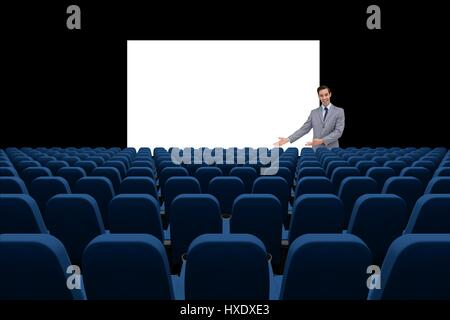 Digital composite of Businessman presenting at blank board in front of 3d empty chairs - Stock Photo
