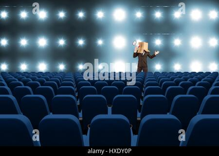 Digital composite of model with box on his had with megaphone at 3d cinema - Stock Photo