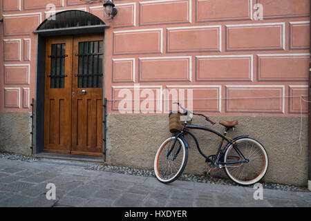 Bike parked outside of home in Monterosso, Italy - Stock Photo
