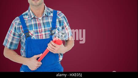Digital composite of Mechanic with red wrench against maroon background - Stock Photo