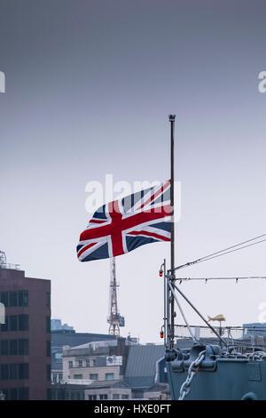 Union Flag Jackstaff Half-mast Bow Prow Ship Naval Jack - Stock Photo