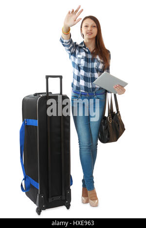 Teen girl 16 years old, with a big, black travel bag on wheels. Young traveler with a huge, black travel bag on - Stock Photo