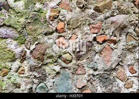 stone wall with real pattern gray color of modern style design decorative uneven cracked surface cement - Stock Photo