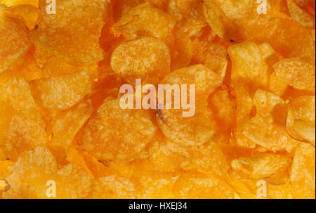 full frame background of potato chips seen from above - Stock Photo