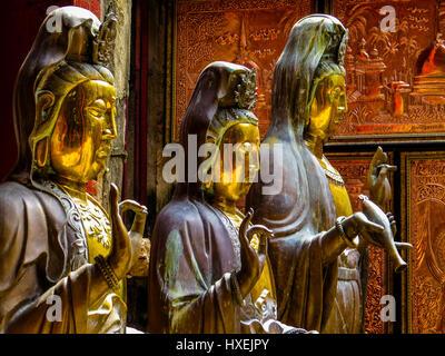 Statues in Gangaramaya Buddhist Temple in Colombo, Sri Lanka - Stock Photo