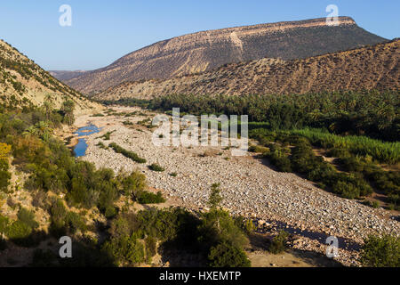 Looking down on a dried up river bed on the edge of the Atlas Mountains in Morocco. - Stock Photo