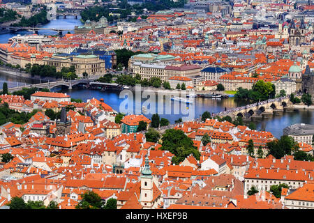 View of Prague (Czech Republic) and the famous Charles Bridge over the River Vitava, as seen from the Petrin lookout - Stock Photo