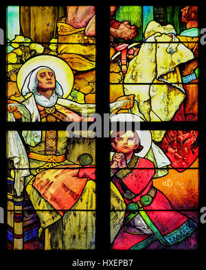 Art Nouveau stained glass window by Alfonse Mucha (1860-1939) in the north nave of Saint Vitus Cathedral, Prague, - Stock Photo