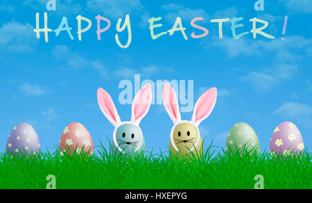 colorful pastel easter eggs with bunny ears in grass with blue sky background and text happy easter - Stock Photo