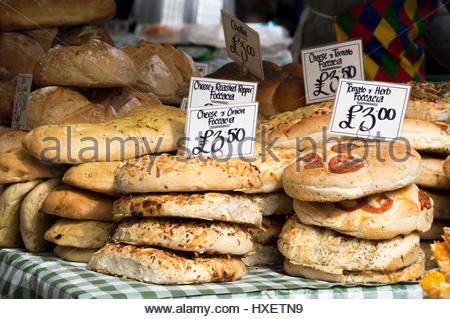 Display of specialty breads and price markers on a market stall in Sevenoaks, Kent - Stock Photo