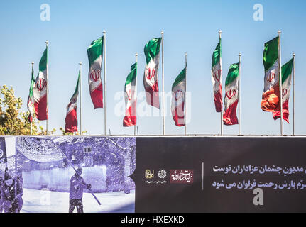 Iranian flags over Azadi Avenue in Tehran city, capital of Iran and Tehran Province - Stock Photo