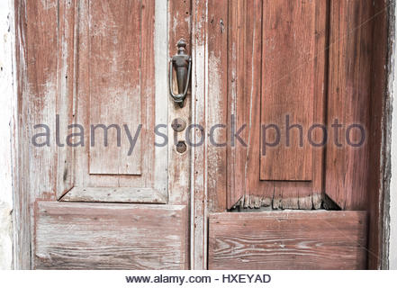 Cuban old weathered and worn out architecture. Close-up detail of wooden door.  Results of economic hardship on - Stock Photo