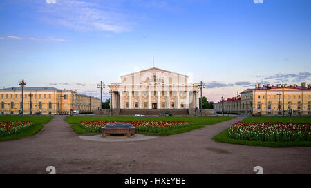 Old Stock Exchange in the morning light, summer sky, green flowerbeds, Saint-Petersburg, Russia - Stock Photo