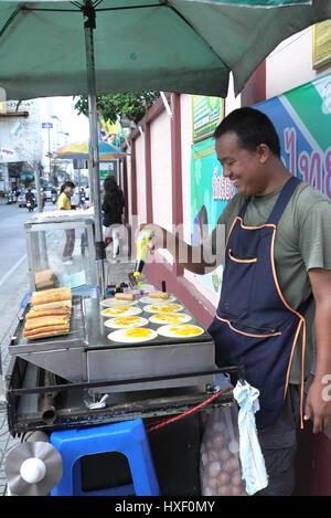 Street food seller in Bangkok, Thailand. - Stock Photo